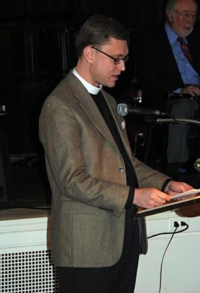 The Rev. Gregory Lisby of Christ Church gives an invocation at a Community Meals, Inc. event in 2011